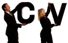 The photo shows a man and a woman carrying the letters CV as they look for their perfect job with their perfect CV
