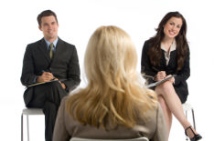 This image shows a woman being interviewed by 2 people. An interview can be daunting but by following this advice you too can be successful.